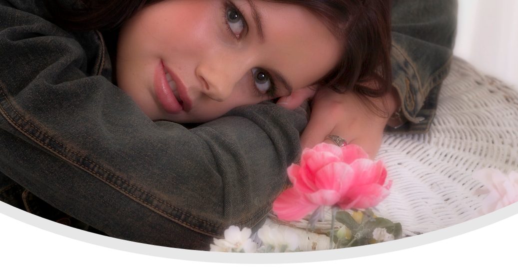 young girl on side with flowers